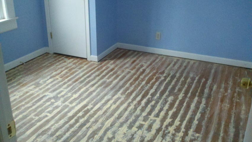 a scratched and damaged hardwood floor