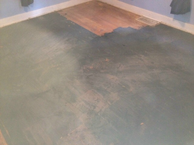 a hardwood floor with black paint stains