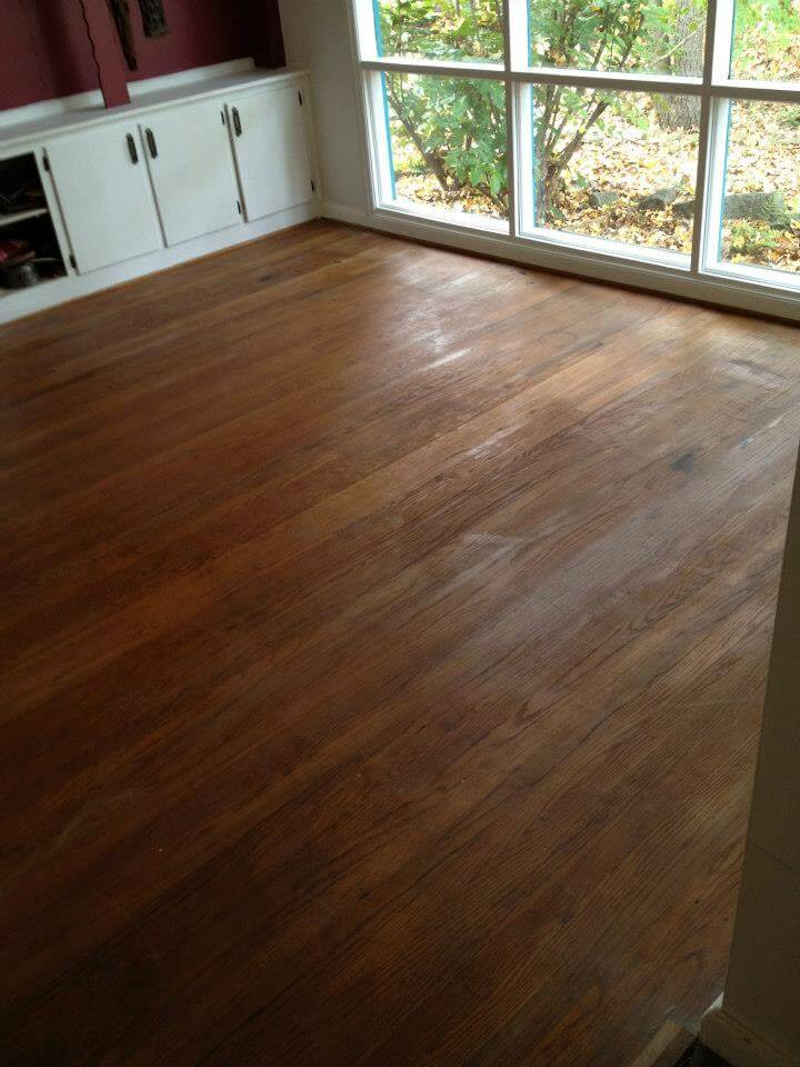 a damaged hardwood floor surface