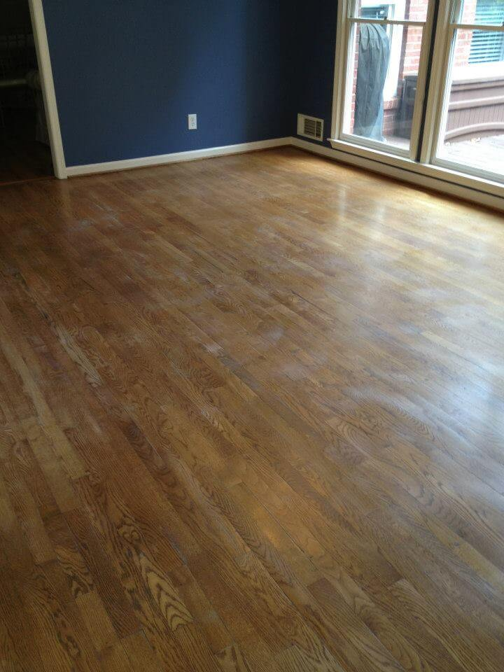a dusty and scratched hardwood floor