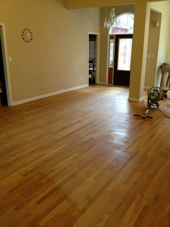 a scratched floor before being resurfaced by Fabulous Floors Nashville